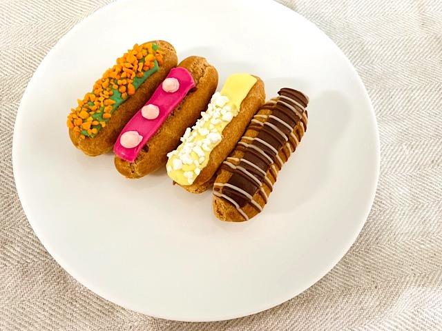 食いしん坊のミニエクレア(ピスタチオ、フランボアーズ、チョコレート、レモンメレンゲ)解凍