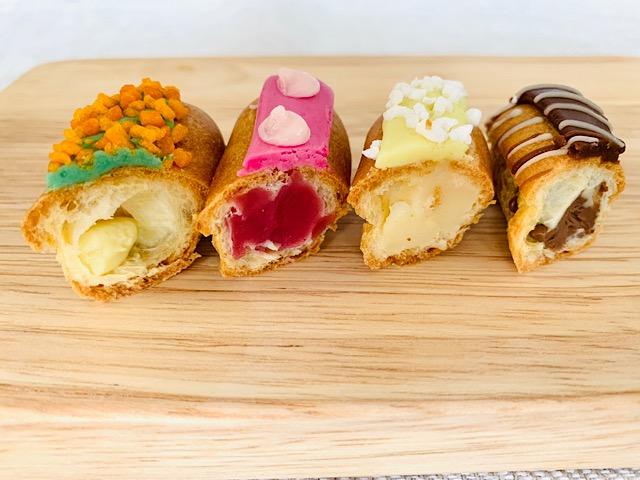 食いしん坊のミニエクレア(ピスタチオ、フランボアーズ、チョコレート、レモンメレンゲ)断面